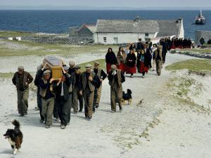 Village Men Carry a Coffin, Women in Red Skirts Follow in Procession by Jim Sugar