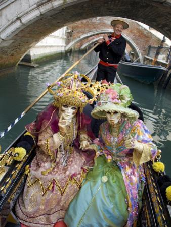 Couple at the Annual Carnival Festival Enjoy Gondola Ride, Venice, Italy by Jim Zuckerman