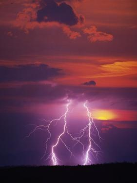 Lightning Storm at Sunset by Jim Zuckerman