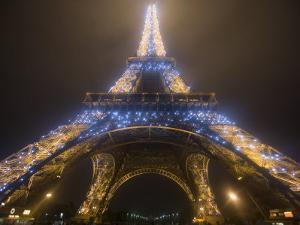 Looking Up at Eiffel Tower in Fog and Rain at Night, Paris, France by Jim Zuckerman