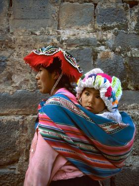 Mother Carries Her Child in Sling, Cusco, Peru by Jim Zuckerman