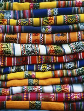 Stack of Colorful Blankets for Sale in Market, Peru by Jim Zuckerman
