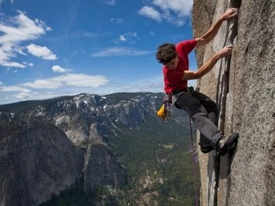 A Climber Grips an Expanse of El Capitan by Jimmy Chin