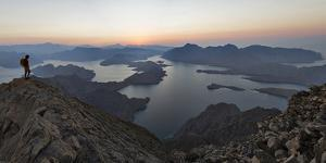 A Climber Looks at the Strip of Land Connecting Oman's Musandam Peninsula to the Arabian Mainland by Jimmy Chin