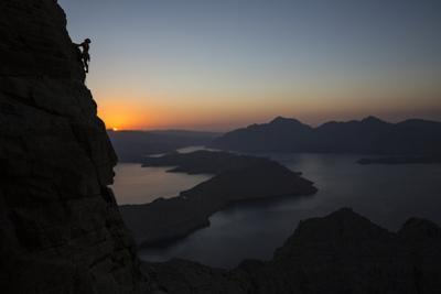 A Climber Scales a Cliff Rising from the Gulf of Oman by Jimmy Chin