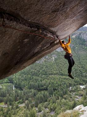 A Climber Scales a Route on Seperate Reality, a Hanging Roof Crack by Jimmy Chin