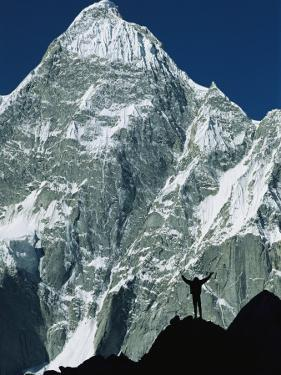 A Climber Silhouetted against Mountains in the Karakoram Range by Jimmy Chin