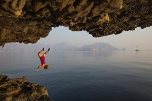 A Climber Takes a Plunge While Deepwater Soloing by Jimmy Chin