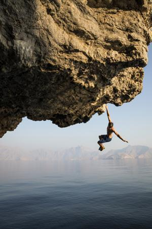 A climber takes a plunge while deepwater soloing. by Jimmy Chin
