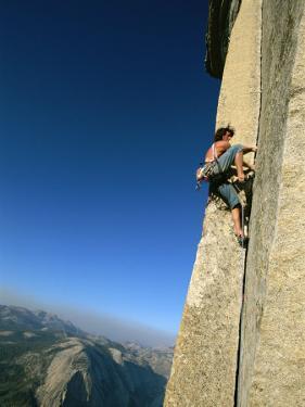 A Man Climbs Half Dome, Yosemite, California by Jimmy Chin