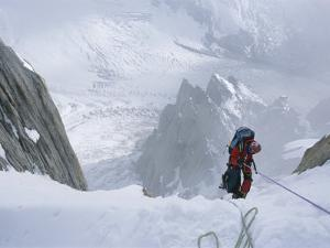 A Man on a Rope in the Karakoram Mountains, Pakistan by Jimmy Chin