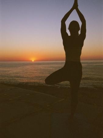A Woman Doing Yoga at Sunrise on the East Cape of Baja, Mexico by Jimmy Chin