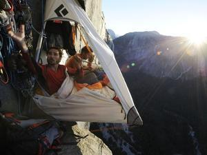 Climbers live in a portaledge when working on a route. by Jimmy Chin