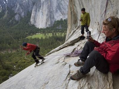 Climbers Swing on a 200-Foot-Long Rope known as the Alcove Swing by Jimmy Chin