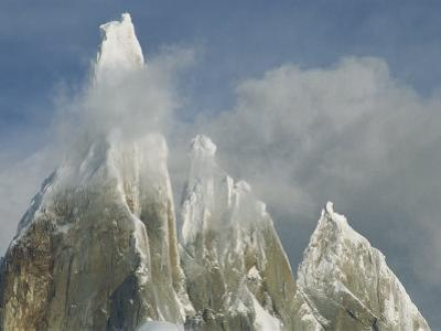The Summit of Cerro Torre Massif Rises Through the Clouds by Jimmy Chin