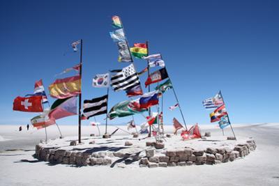 Flags in a Salt Desert of Salar De Uyuni by jjspring