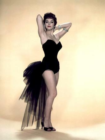 https://imgc.allpostersimages.com/img/posters/joan-collins-british-actress-born-may-23rd-1933-here-1958-photo_u-L-Q1C28PY0.jpg?artPerspective=n