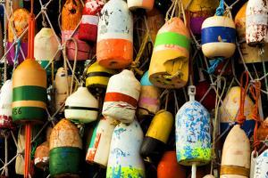 Buoys on a Wall at Apalachicola, Florida, USA by Joanne Wells