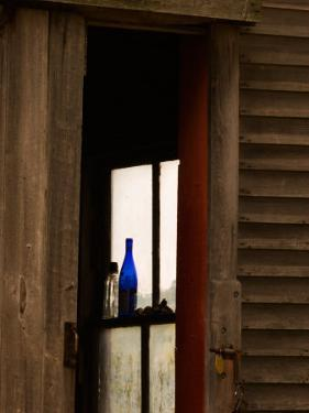 Old Blue Bottle in Window of Barn in Rural New England, Maine, USA by Joanne Wells