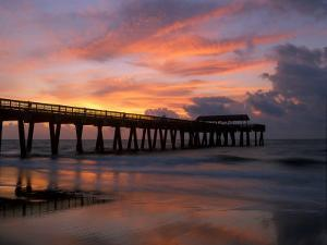 Pier at Sunrise with Reflections of Clouds on Beach, Tybee Island, Georgia, USA by Joanne Wells