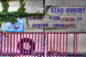 USA, Florida, Apalachicola, Old Oyster House on Apalachicola Bay by Joanne Wells
