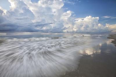 USA, Georgia, Tybee Island. Clouds and waves in morning light at the beach. by Joanne Wells