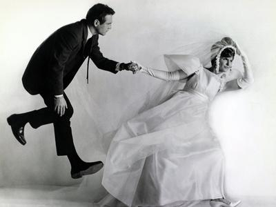 https://imgc.allpostersimages.com/img/posters/joanne-woodward-paul-newman-a-new-kind-of-love-1963-directed-by-melville-shavelson_u-L-Q10T3E90.jpg?artPerspective=n