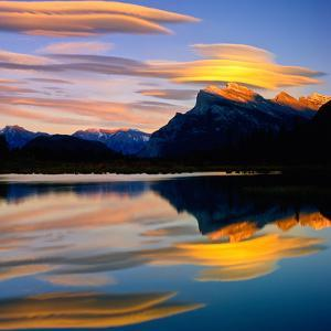 Beautiful Lenticular Clouds Drift over Fisrt Vermillion Lake to Rest onTop of Mt Rundle by Joao Maia
