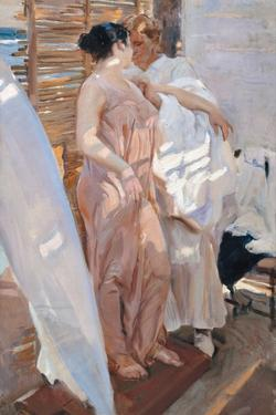 The Pink Robe. after the Bath by Joaquín Sorolla y Bastida