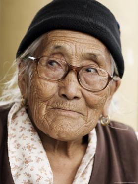 Portrait of a Tibetan Woman, Mcleod Ganj, Dharamsala, Himachal Pradesh State, India by Jochen Schlenker