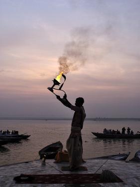 Sunrise Ritual at the River Ganges, Varanasi (Benares), Uttar Pradesh, India, Asia by Jochen Schlenker