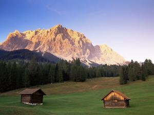 Zugspitze and Barns at Dusk, Wetterstein, Austrian Alps, Austria, Europe by Jochen Schlenker