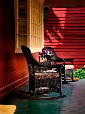 An American Front Porch with Wooden Boarding and Two Whicker Rocking Chairs by Jody Miller