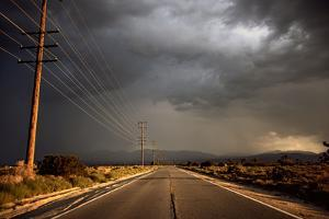 Tarmac Road Disappearing into Distance in USA by Jody Miller