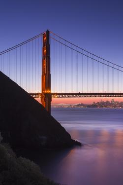 Sunrise Of A Single Bridge Of The Golden Gate Bridge, With The San Francisco Skyline And Bay Bridge by Joe Azure