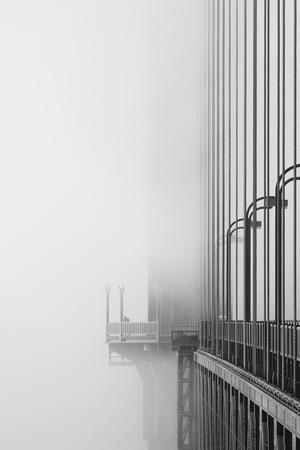 The Cables And Sidewak Of The Golden Gate Bridge Disappearing Into The Fog