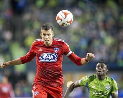 2014 MLS Playoffs: Nov 10, FC Dallas vs Seattle Sounders - Obafemi Martins, Matt Hedges by Joe Nicholson