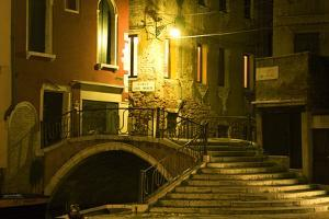 A Stairway and Bridge Over a Canal At Night by Joe Petersburger