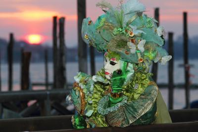 A Woman in a Mask and Costume for Carnival At a Gondola Stand
