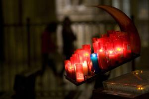Burning Candles in Plastic Tubes in the Toledo Cathedral by Joe Petersburger
