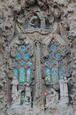 Ornate Sculpture and Stained Glass Windows at Gaudi's La Sagrada Familia Cathedral by Joe Petersburger