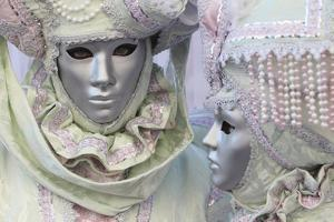 Women in Colorful Masks and Costumes During Carnival by Joe Petersburger