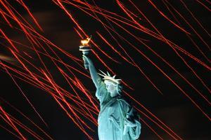 Fireworks Surrounding Statue of Liberty by Joe Polimeni