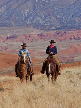 Cowboy and Cowgirl Riding Through Scenic Hills of the Big Horn Mountains, Shell, Wyoming, USA by Joe Restuccia III