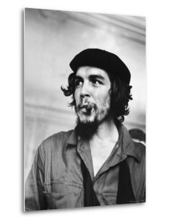 "Cuban Rebel Ernesto ""Che"" Guevara with Lit Cigar Clenched Between Teeth and Left Arm in a Sling by Joe Scherschel"