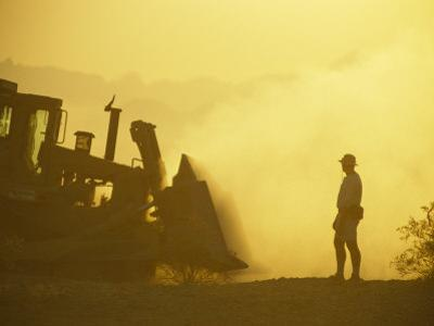 A Biologist Watches for Desert Tortoises as Bulldozers Roll Nearby by Joel Sartore