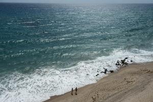 A Couple Strolls Along the Beach of the Florida Coast by Joel Sartore
