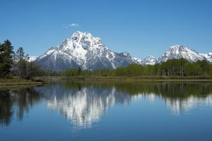 A Mountain Reflected in a Lake in Yellowstone National Park, Wyoming by Joel Sartore