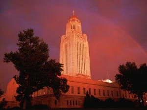 A Rainbow Shines Over the Nebraska State Capitol after a Storm by Joel Sartore