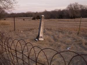 A Small, Fenced in Graveyard at Steven's Creek Farm in Nebraska by Joel Sartore